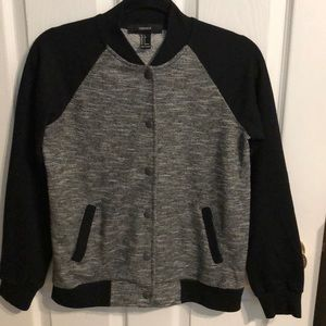 Black and grey material blazer